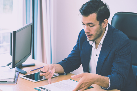 Business man is taking note on interview resume report