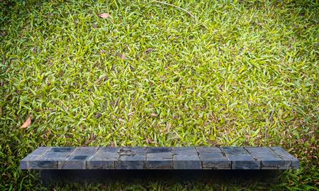 Empty stone shelf on green grass background Stock Photo
