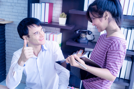 Boss thumb up for female worker compliment