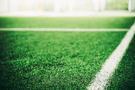 White line on Green grass sport field for sport concept Фото со стока