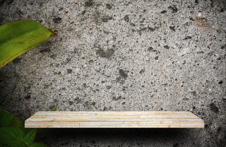 Blank rock stone display shelf on plant cement wall Stock Photo