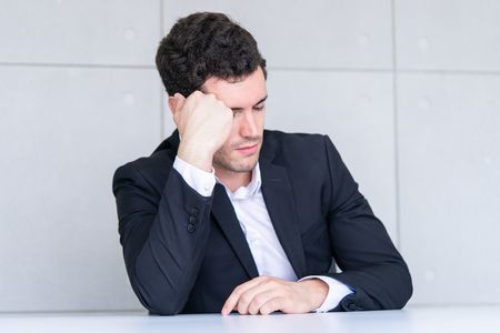 Tired business man fall asleep on office table