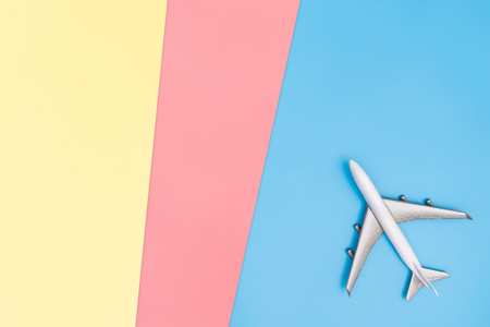 plane on blue pink yellow copy space for poster and text