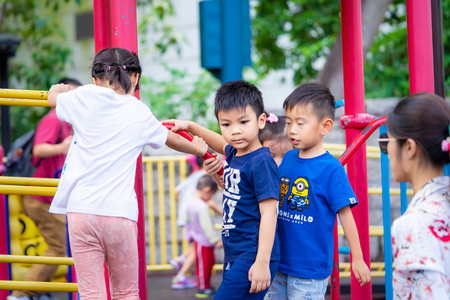 Tokyo, Japan - October 14, 2018: Children and parent are having good time in Kowloon park playground. Фото со стока
