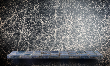 Empty rock stone shelf on black leather background Stock Photo