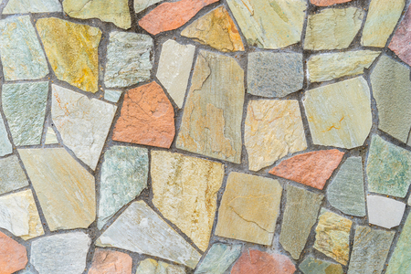 Mur de blocs de carrelage en pierre pour le fond de texture