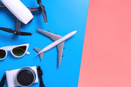 Hi tech travel gadget and accessories on blue and pink yellow copy space Imagens - 113294251