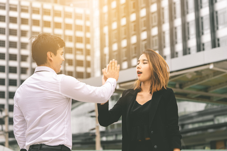 Business lover couple is hi five for success in modern city Imagens