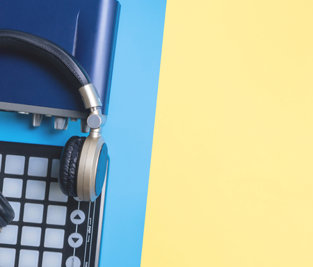 Home Music studio instrument with headphone on blue yellow copy space for Music concept