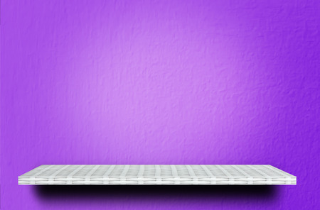 weaver wooden shelf counter on purple cement texture Stock Photo