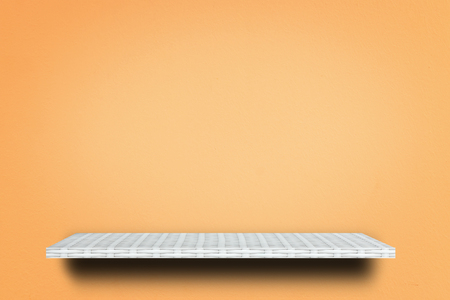weaver wooden shelf counter on orange background