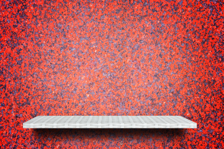 Empty white weaving shelf counter on red stone texture Stock Photo