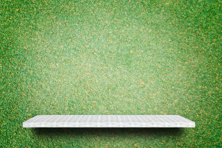 Empty weaving shelf on green grass background