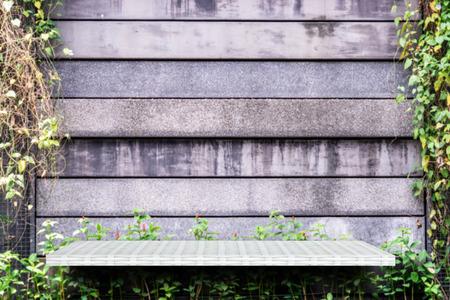 Empty weaving shelf on green garden background Stock fotó