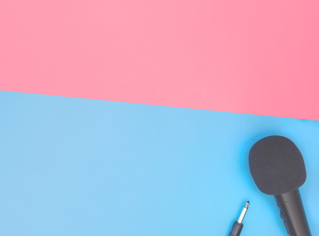 Black microphone on blue pink background for music concept Stok Fotoğraf