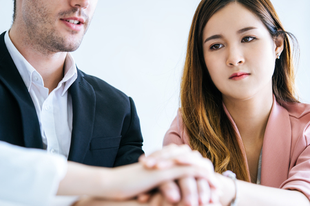 Woman look worry in Team hand together in business meeting