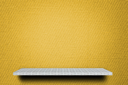 Empty weaver shelf counter on yellow paper background