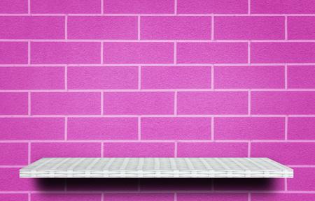 Empty weaver shelf counter on pink brick wall 写真素材