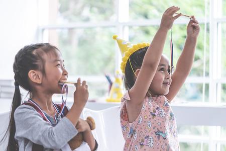 Little girl is bitting gold medal for student award