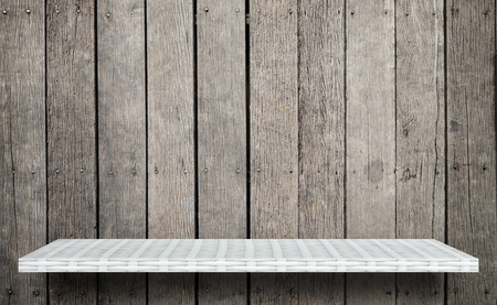 white shelf display counter on grunge wooden background Reklamní fotografie - 114763501
