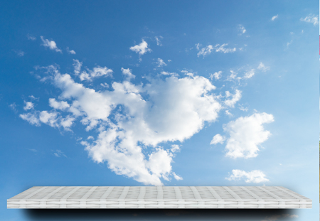 white shelf display counter on cloud sky background