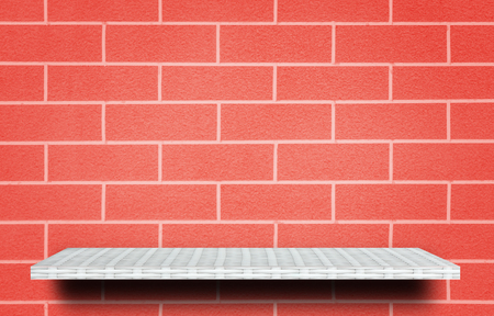 Empty white shelf on red brick background for product display