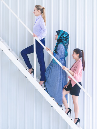 Team of success business woman walking up the stair Stock fotó