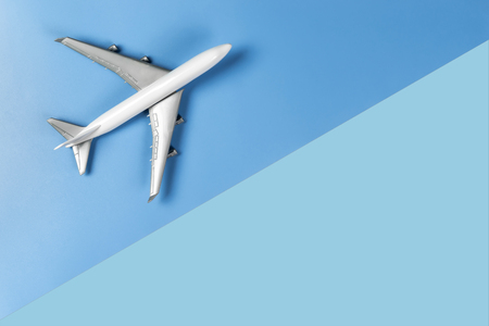 Toy plane is traveling the world concept on blue