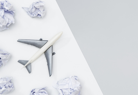 Toy plane is traveling the world concept on white and gray