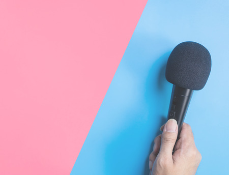 Black microphone on blue pink background for music concept 스톡 콘텐츠