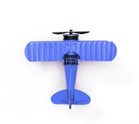 Avion jouet en métal bleu isolated on white Banque d'images