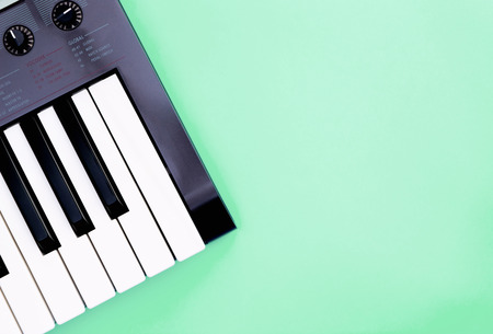 Music keyboard synthesizer instrument on teal copy space for Music poster concept
