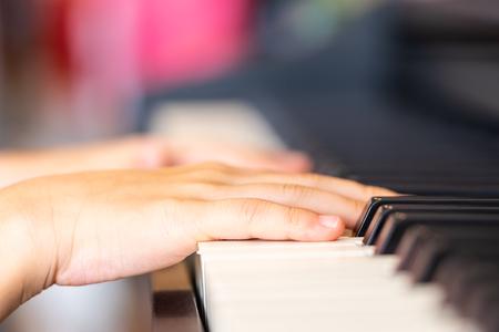 Children Hand is playing Music keyboard Piano Reklamní fotografie