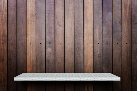 Empty white shelf on wooden background for product display