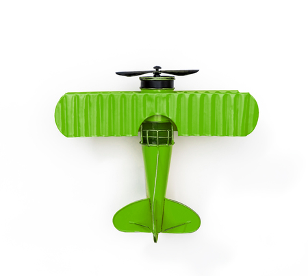 green Metal toy plane isolated on white Imagens