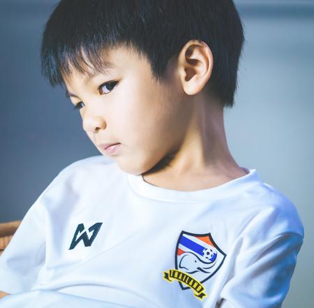 Bangkok, Thailand - november 16, 2018: little boy wearing Thai soccer team shirt suppoting Thai national team.