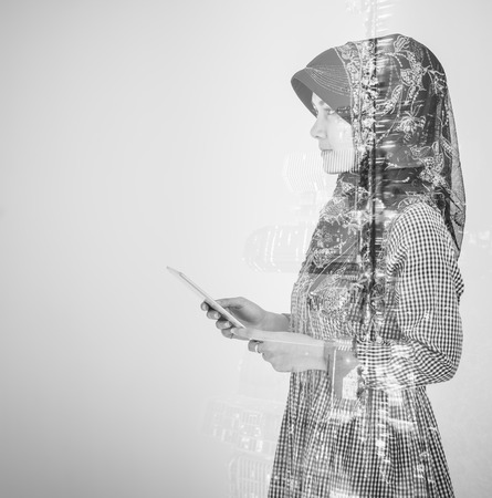 Islam muslim woman with city double exposure in black and white