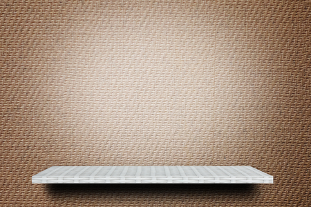 Empty white shelf on brown background for advertising backdrop