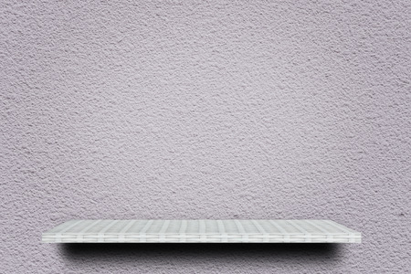 empty white shelf on cement wall for product display