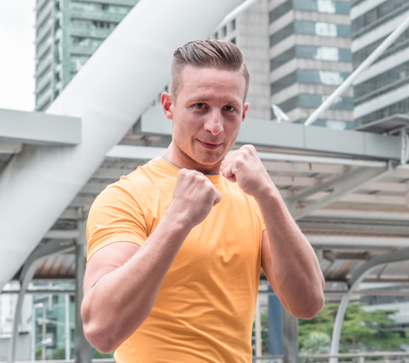 Fighter sport fitness athletic man in boxing stand in modern city Stock Photo