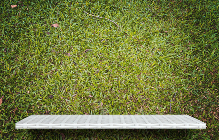 empty white shelf on gree grass for product display Stock fotó
