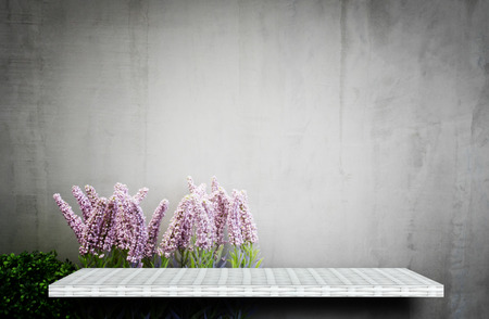 empty white shelf on flower garden for product display