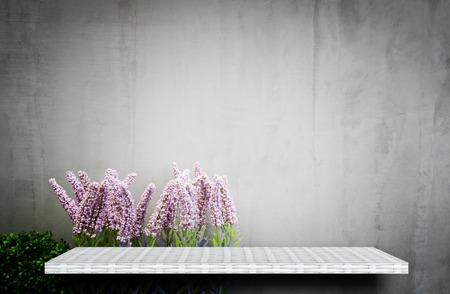 empty white shelf on flower garden for product display