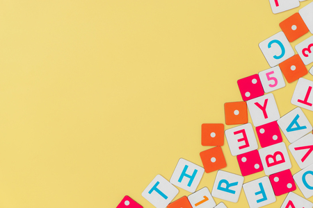 Children Toys frame on yellow background Top view flat lay with copy space Reklamní fotografie