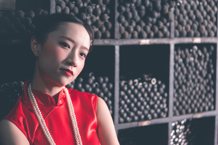 Chinese woman in a steel metal rod industrial store