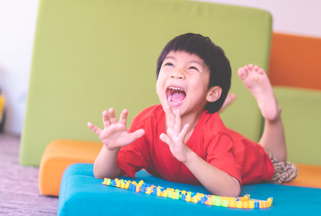 Young boy screaming out un happy with his toy