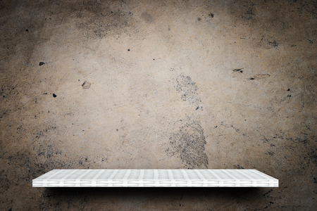 Empty wooden shelf on dirty cement background for product display