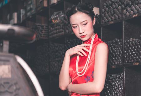 Chinese woman in a steel metal rod industrial store Reklamní fotografie