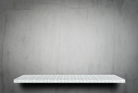 Empty white shelf on gray cement background for product display