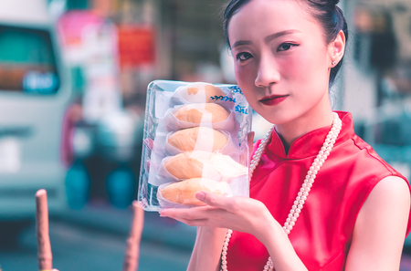 Chinese girl is holding Thai Durian in package from Bangkok china town
